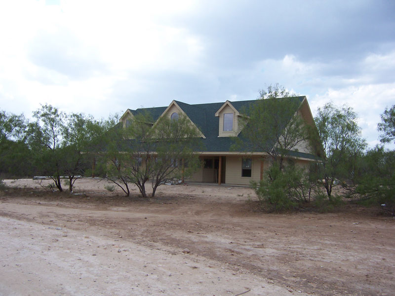 Texanna custom homes texanna custom homes will build on for Custom built ranch homes